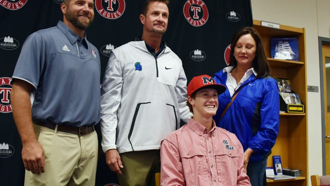 Tate High School's Trent Jeffcoat (center, right) is joined by (from left) Tate head coach Karl Jernigan, his father Mike and mother Ginger as he signs a scholarship on Nov. 8, 2017 to play baseball at the University of Mississippi.