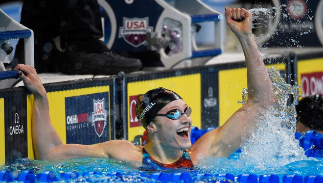 Rancocas Valley High School graduate Kelsi Worrell reacts after winning her preliminary heat in the women's 100-meter butterfly at the U.S. Olympic swimming trials on June 26.