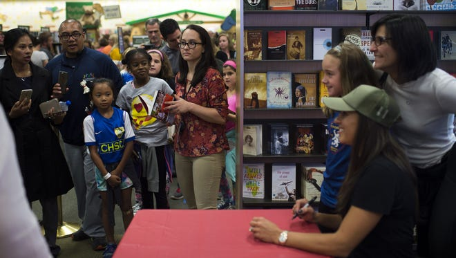 People line up for photos with Carli Lloyd during a book signing Thursday,  at Barnes & Noble in Cherry Hill.