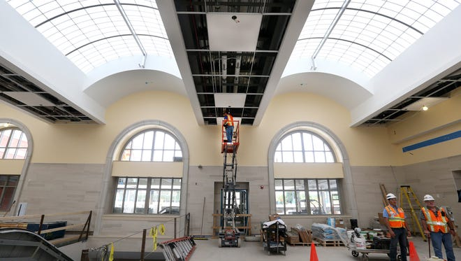 Travelers will find a spacious and bright  atrium area inside the main entrance of the new Rochester train station.