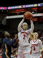 Louisville's Myisha Hines-Allen grabs one of her 12