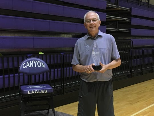 Canyon Texas) girls basketball coach Joe Lombard with the ALL-USA Coach of the Year Trophy