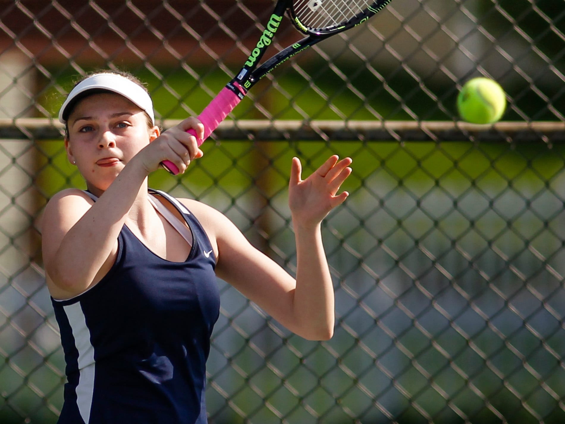Hannah Vogelsang of Haslett volleys against Lakewood No. 1 singles junior Kendra Stoepker May 19, 2016, during the Div. 3 Tennis Regional final at Haslett High School. [MATTHEW DAE SMITH | for the Lansing State Journal]