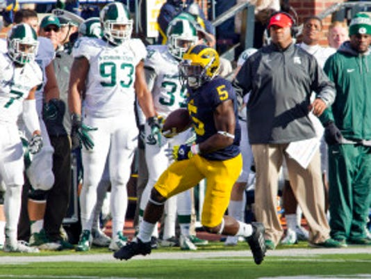 Michigan defensive back Jabrill Peppers (5) rushes in the second quarter of an NCAA college football game against Michigan State in Ann Arbor, Mich., Saturday, Oct. 17, 2015. (AP Photo/Tony Ding)