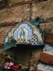 This lovely little ceramic shrine hung in the adobe greenhouse of a hacienda in the state of Michoacan.