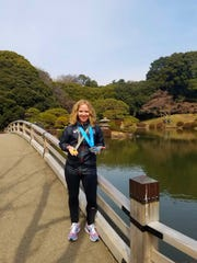 Wendy Garrett of Turner poses with her medals for completing the Tokyo Marathon and the Abbott World Marathon Majors.