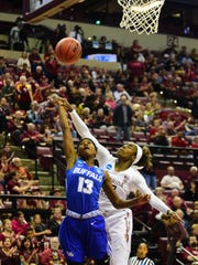 Redshirt junior guard Imani Wright defends the rim in the Seminoles' second-round loss to Buffalo in the NCAA Tournament.