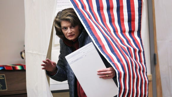 Sen. Lisa Murkowski, R-Alaska, emerges from a voting