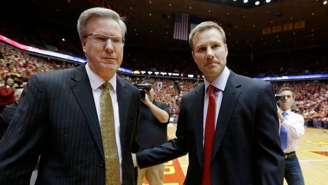 Iowa head coach Fran McCaffery, left, talks with Iowa State head coach Fred Hoiberg Dec. 13 in Ames.