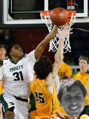 Trinity's Jay Scrubb (31) defended St. X's Tyler Barnes (15) during their game at Broadbent Arena.Jan. 6, 2017