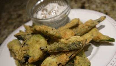 Dredged in a delicious organic cornmeal, and fried to a light crispy crunch, the first okra and eggplants of the summer season shine with a tasty seasoned yogurt dip.