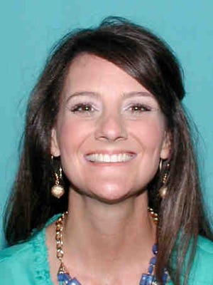 Melissa Doise, 44, turned herself in to Caddo Correctional Center to for felony theft charges.
