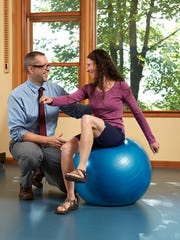 John Roger offers pointers to his wife Tracy Roger at MOST Physical Therapy.