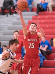 Bucyrus' Ryan Evans attempts a basket.