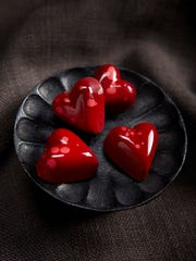 Dark chocolate hearts with a coating of raspberry,