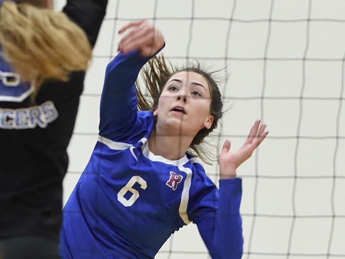 Action photos from the Reno at McQueen girls volleyball
