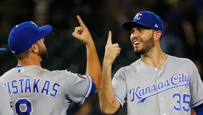 Mike Moustakas, left, and Eric Hosmer celebrate the Kansas City Royals' seventh consecutive victory on Tuesday.