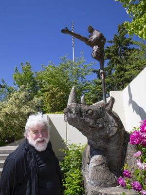"Jerry Williams visits his 1994  ""Balancing Act"" sculpture in front of Springfield City Hall. [Chris Pietsch/The Register-Guard] - registerguard.com"