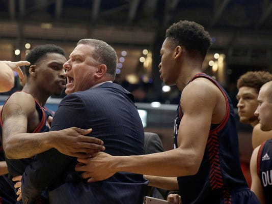 Duquesne head coach Brian Nash reacts after being called for a technical foul during the first half of an NCAA college basketball game against Dayton, Tuesday, Feb. 9, 2016 in Dayton, Ohio. (AP Photo/Tony Tribble)