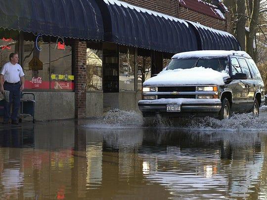 Flood waters slowed traffic outside the Dock Deli on