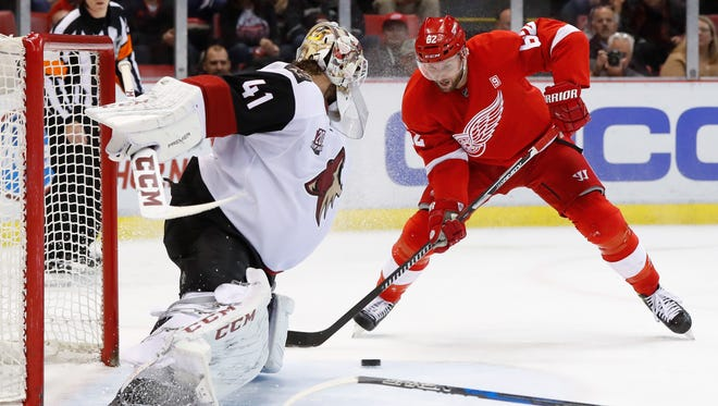 Coyotes goalie Mike Smith (41) stops a shot by Red Wings' Thomas Vanek (62) in the second period Tuesday at Joe Louis Arena.