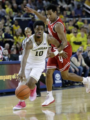 Michigan guard Derrick Walton Jr. (10) drives around Indiana guard Devonte Green during the second half Thursday. Walton scored 21 in the Wolverines' 90-60 victory.