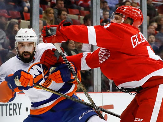 Red Wings center Luke Glendening checks Islanders defenseman