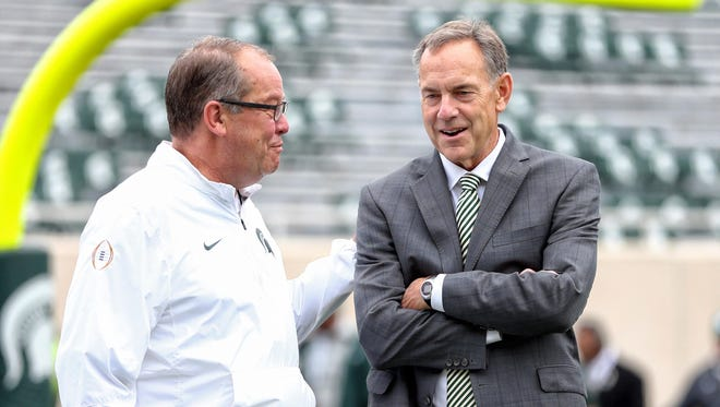 Mike Carter/USA TODAY Sports Spartans football coach Mark Dantonio, right, and A.D. Mark Hollis talk before a game. Oct 29, 2016; East Lansing, MI, USA; Michigan State Spartans head coach Mark Dantonio (right) and Michigan State Spartans A.D. Mark Hollis talk before a game against the Michigan Wolverines at Spartan Stadium. Mandatory Credit: Mike Carter-USA TODAY Sports