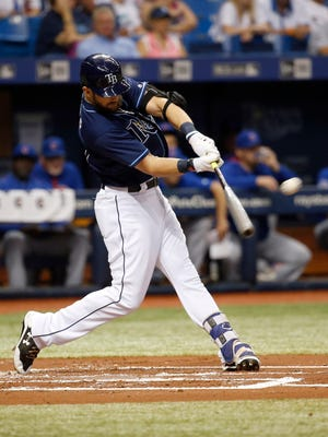 Sep 20, 2017; St. Petersburg, FL, USA;Tampa Bay Rays right fielder Steven Souza Jr. (20) hits a solo home run during the first inning against the Chicago Cubs  at Tropicana Field.