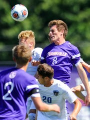 University of Evansville's Ian McGrath (8) heads the ball between Fort Wayne defenders during the ProRehab Aces Soccer Classic at Arad McCutchan Stadium, Sunday, Sept. 11, 2016. UE beat Fort Wayne 3-1.