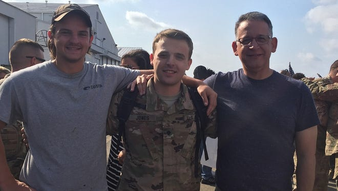 Aaron Jones is pictured with his younger brother, Joshua, and his father, William. William is also a member of the Tennessee National Guard. He deployed in 2005.