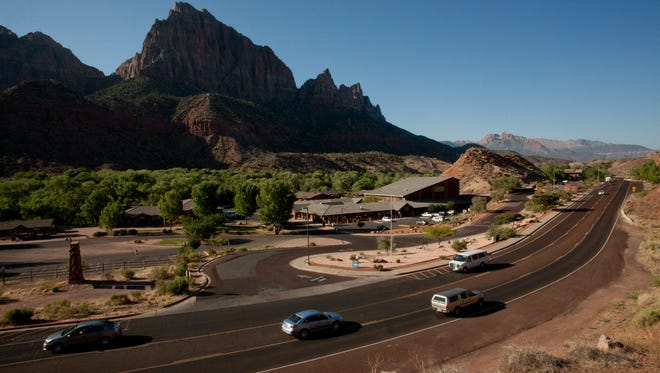 Drivers navigate along state Route 9 near the entrance to Zion National Park. Park officials are planning a series of prescribed fires within the main canyon next week to prevent larger fires in the future.