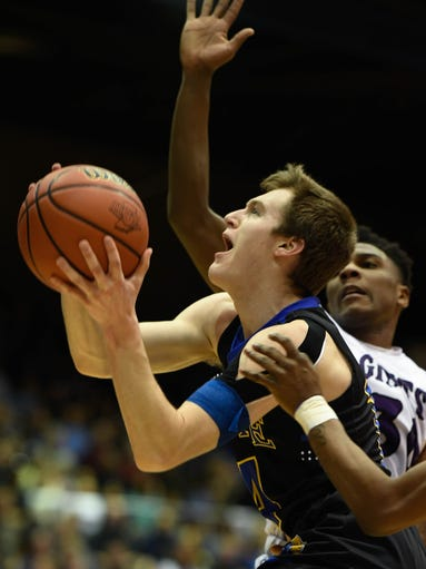 Castle's Brandon Eades drives past defensive pressure