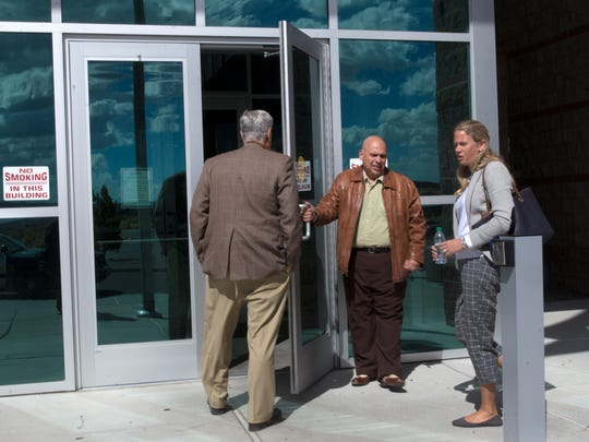 Daniel Goldberg, center holds the door as he enters the Farmington District Court, on Thursday, Oct. 12, 2017.