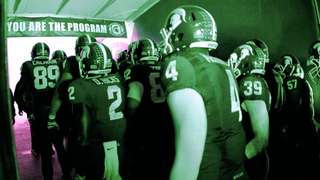 Michigan State players prepare to enter Spartan Stadium from the player tunnel before their game against Nebraska on Oct. 4. The Spartans hung on for a 27-22 victory.