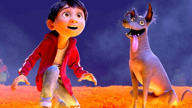 """Miguel (voice of Anthony Gonzalez) and his dog Dante take a trip to The Land of the Dead in animated adventure """"Coco."""""""