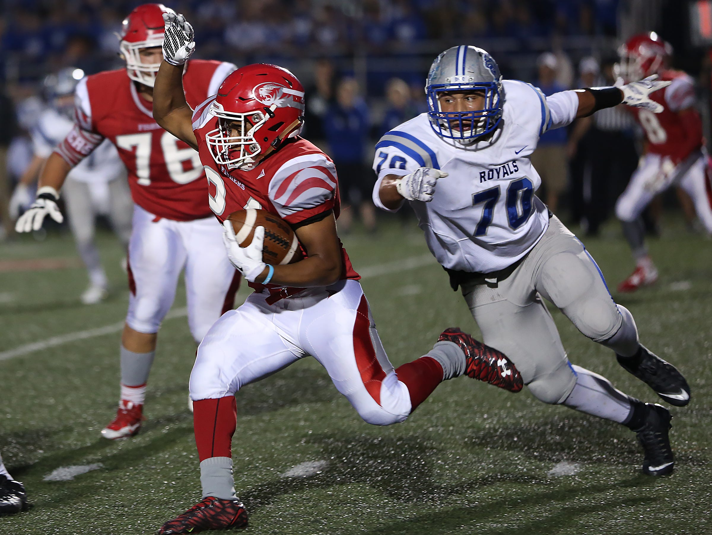 Fishers #24 Jermaine Huddleston runs for yards as HSE #70 Collin Miller comes from behind in first half action during the high school football sectionals Round 1 game of Hamilton Southeastern at Fishers, Friday, October 23, 2015. Fishers leads 24-7 at the half.