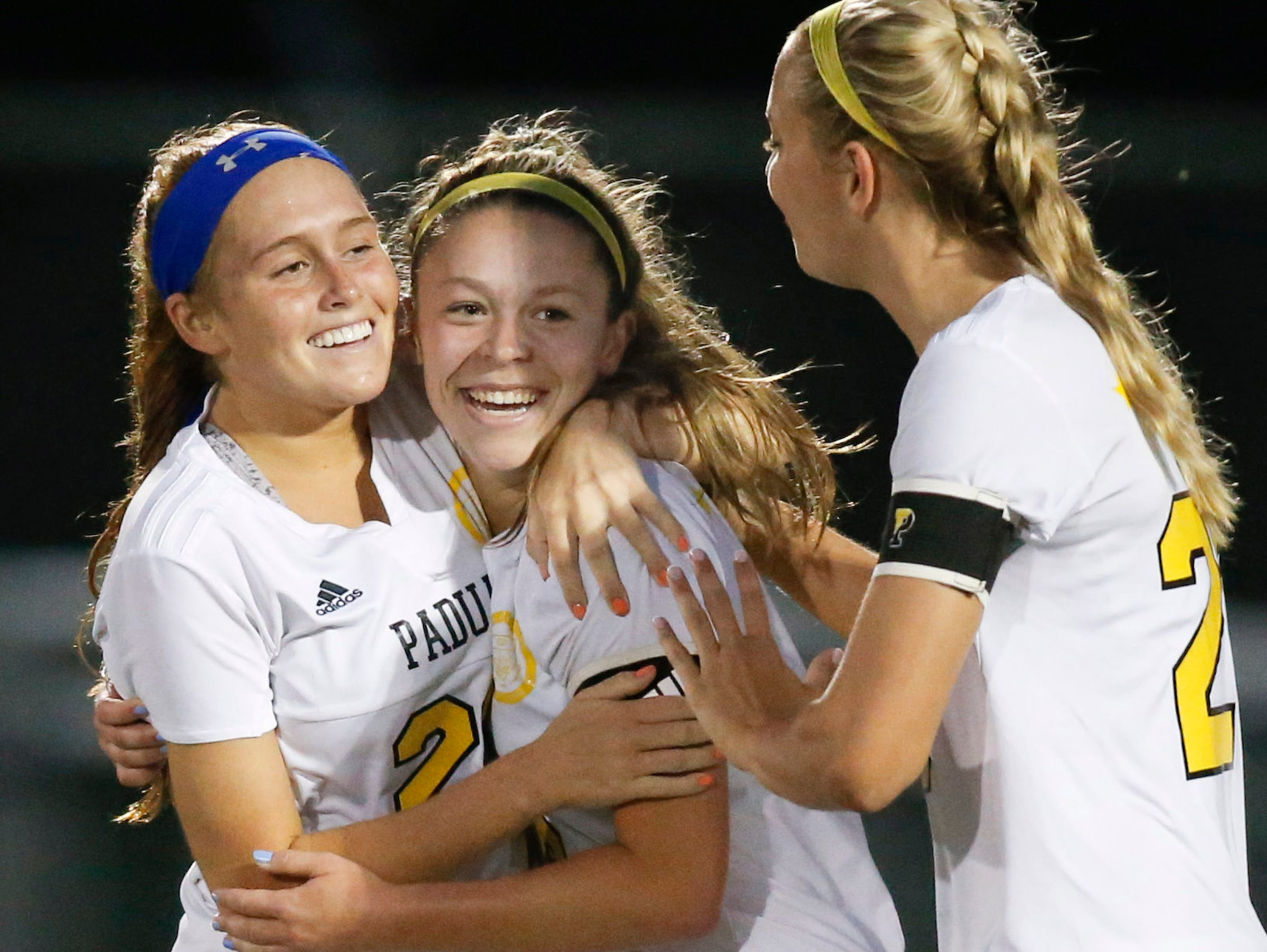 Padua's Sarah Brush (center) celebrates her opening goal with Mackenzie Scully (left) and Molly Drach in the first half against Caesar Rodney in the DIAA Division I state title game at Smyrna High School Friday.