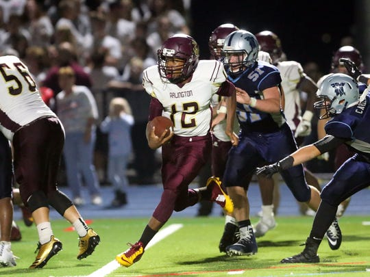 Arlington quarterback Xavier Powell (12) runs out of the pocket during their 13-7 win over John Jay at John Jay High School in Hopewell Junction on Friday, September 15, 2017.