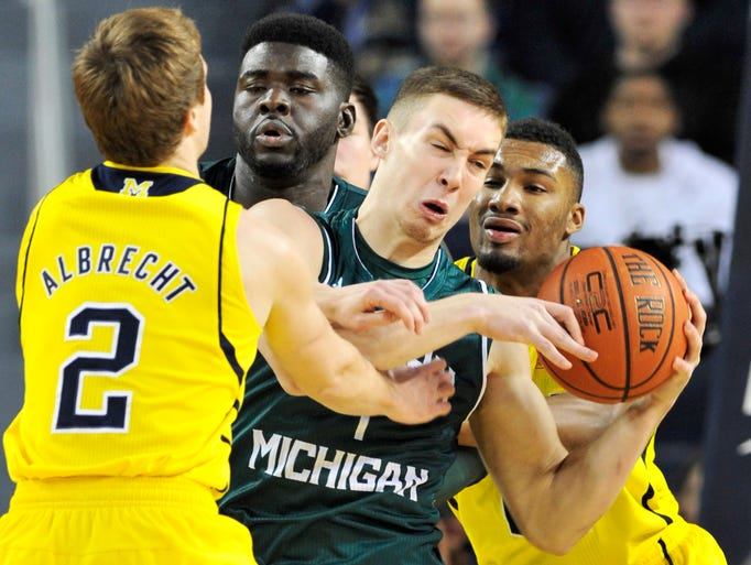 Michigan's Spike Albrecht, left, and Zak Irvin, right,