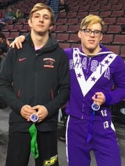 Russell Rucklos of Foothill, left, and Quinn Simard of Shasta pose Saturday with the medals they won at the CIF state wrestling championships in Bakersfield.
