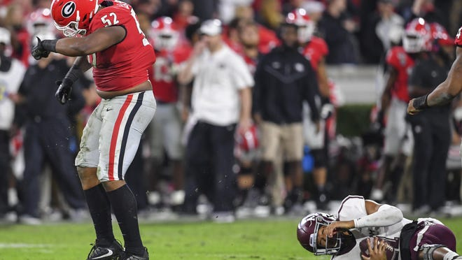 Georgia defensive lineman Tyler Clark celebrates sacking Texas A&M quarterback Kellen Mond last season at Sanford Stadium. Mond is entering his fourth season as the Aggies' starter this fall.