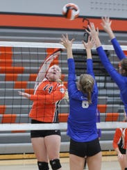Grinnell's Nicole Popp, 14, attacks the Clear Creek