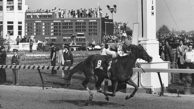 In a May 3, 1980, photo, Genuine Risk, ridden by jockey Jacinto Vasquez, crosses the finish line to win the Kentucky Derby at Churchill Downs in Louisville, Ky. Genuine Risk was one of only three fillies to win the Kentucky Derby.