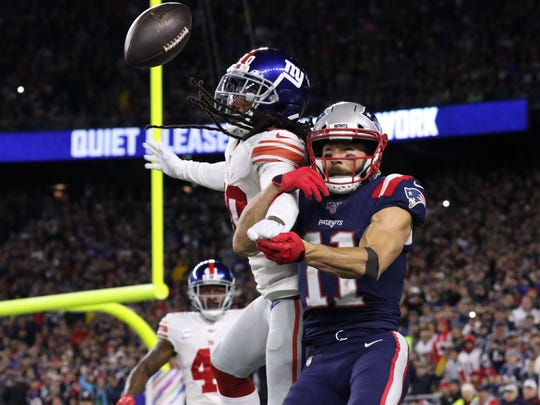 Oct 10, 2019; Foxborough, MA, USA; New York Giants cornerback Janoris Jenkins (20) breaks up a pass intended for New England Patriots wide receiver Julian Edelman (11) during the first half at Gillette Stadium. Mandatory Credit: Paul Rutherford-USA TODAY Sports