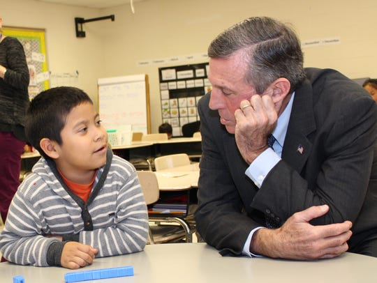 Gov. John Carney talks with a student at North Georgetown