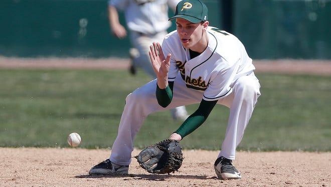 Green Bay Preble shortstop Connor Lemmens gloves a ground ball against Stevens Point Area High School at Joannes Stadium April 16,  2016.