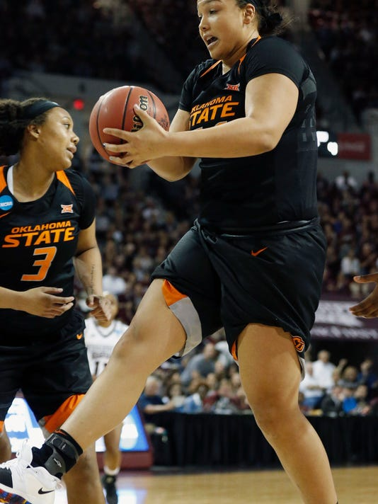 Oklahoma State center Kaylee Jensen, right, pulls down a rebound against Mississippi State during the first half of a round-two game in the NCAA women's college basketball tournament in Starkville, Miss., Monday, March 19, 2018. (AP Photo/Rogelio V. Solis)