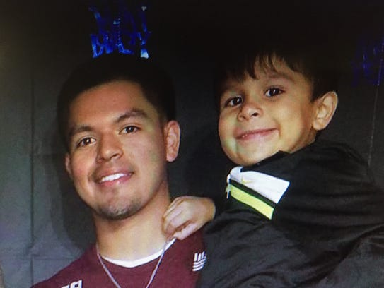 Jordan Martinez poses for a photo with his brother,