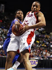 Delaware State Hornets guard Todd Hughes (35) and Hampton Pirates guard Deron Powers (11) fight for a rebound during the second half in the final of the MEAC Conference tournament at Norfolk (Va.) Scope Arena.